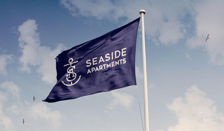 Seaside Apartments logo on flag